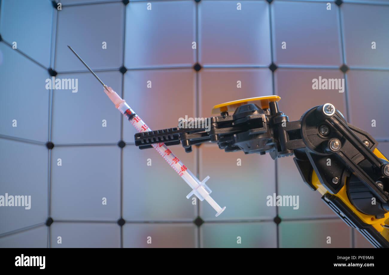 Medical syringe in the   robot arm, Model of industrial robot manipulator, robot hand  with medical syringe - Stock Image