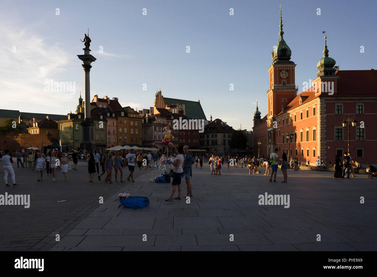 The castle square in Warsaw is a meeting place for tourists and locals who gather here to view street artists and concerts, Poland 2018. - Stock Image