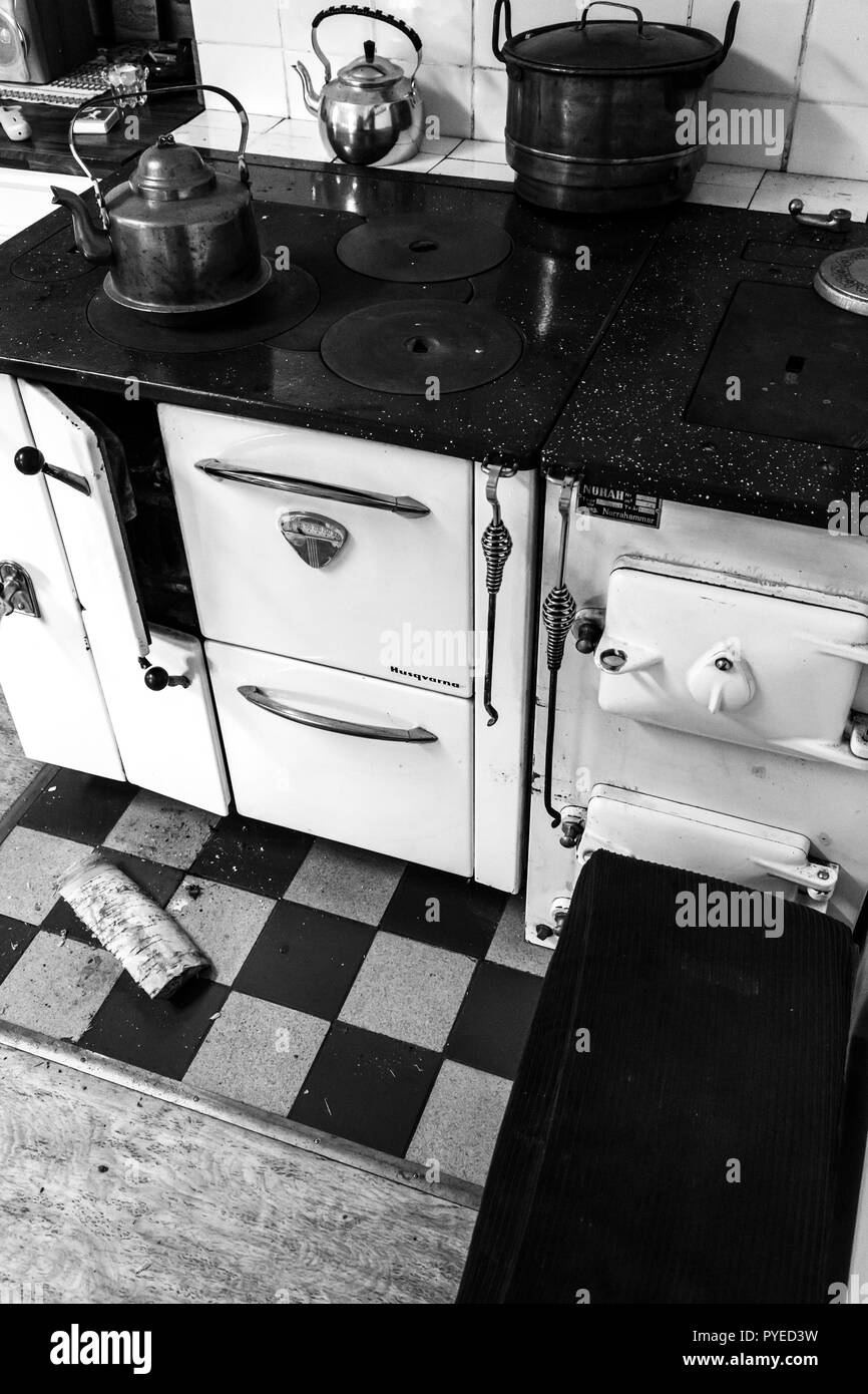 Vintage wood or coal fired cooking stove in an old Swedish farm house in northern Sweden - Stock Image