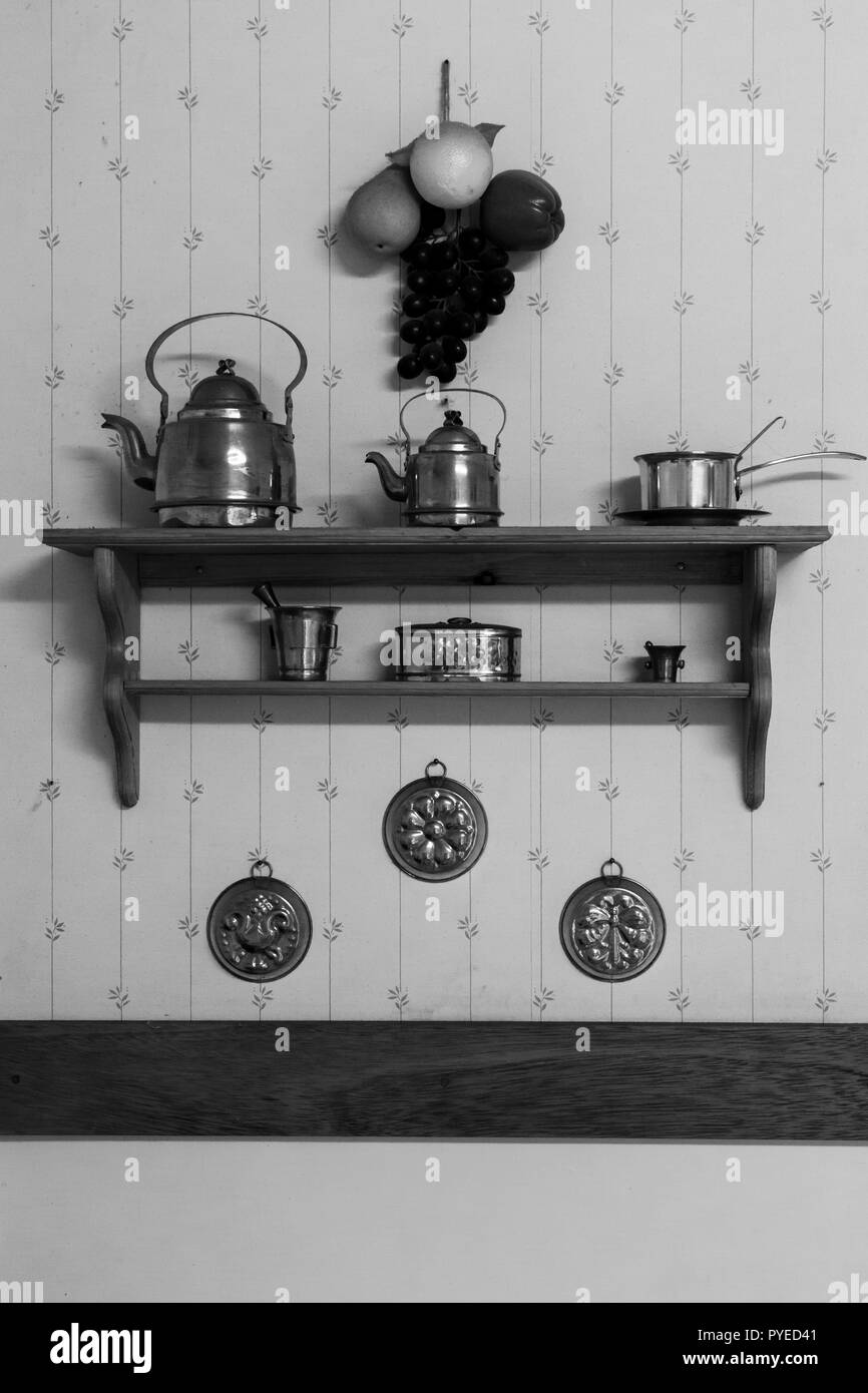 Copper tea pots and kitchen wall decorations in an old Swedish farm house in northern Sweden - Stock Image
