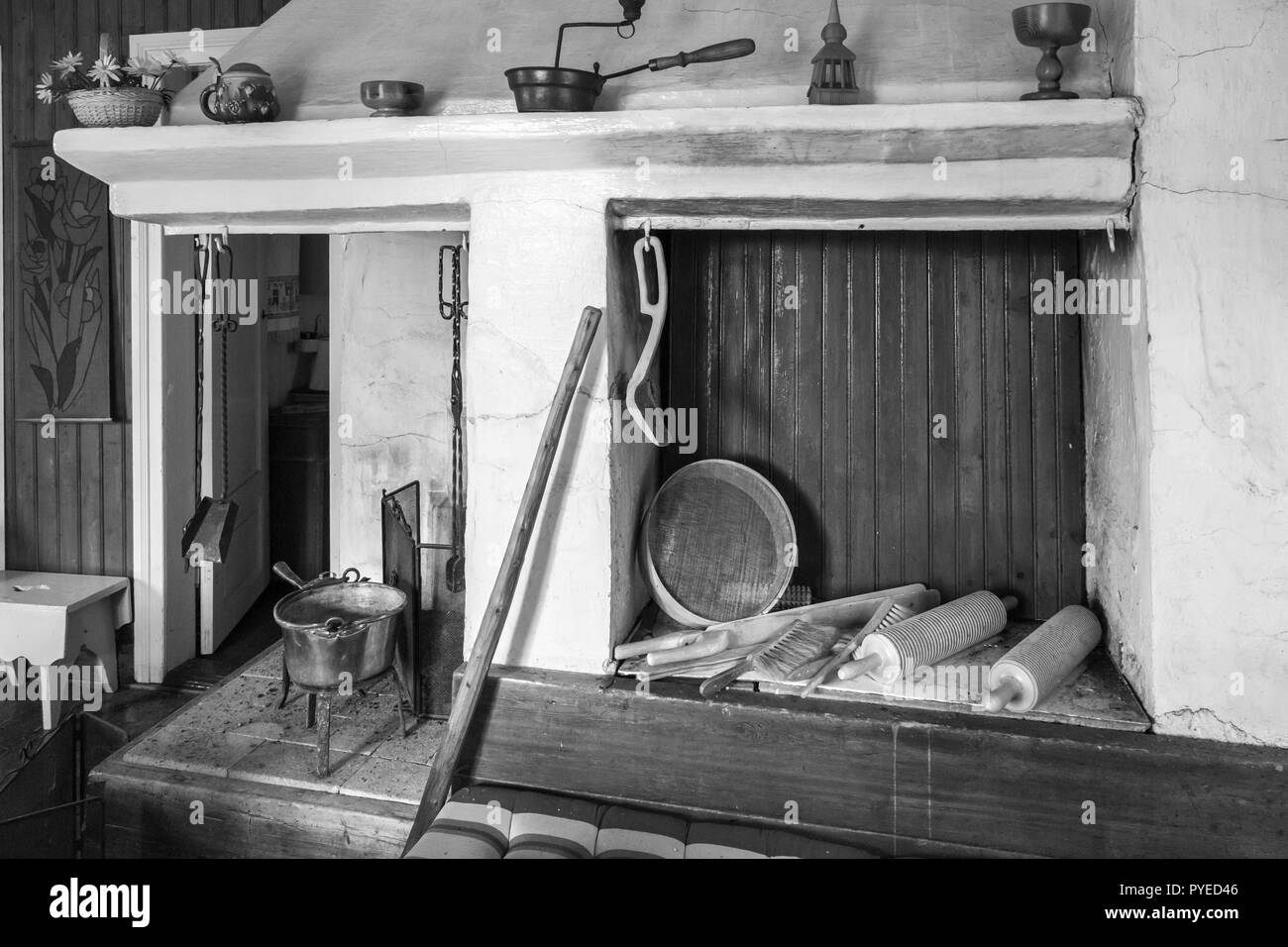 Cooking fireplace  and oven in an old Swedish farm house in northern Sweden - Stock Image