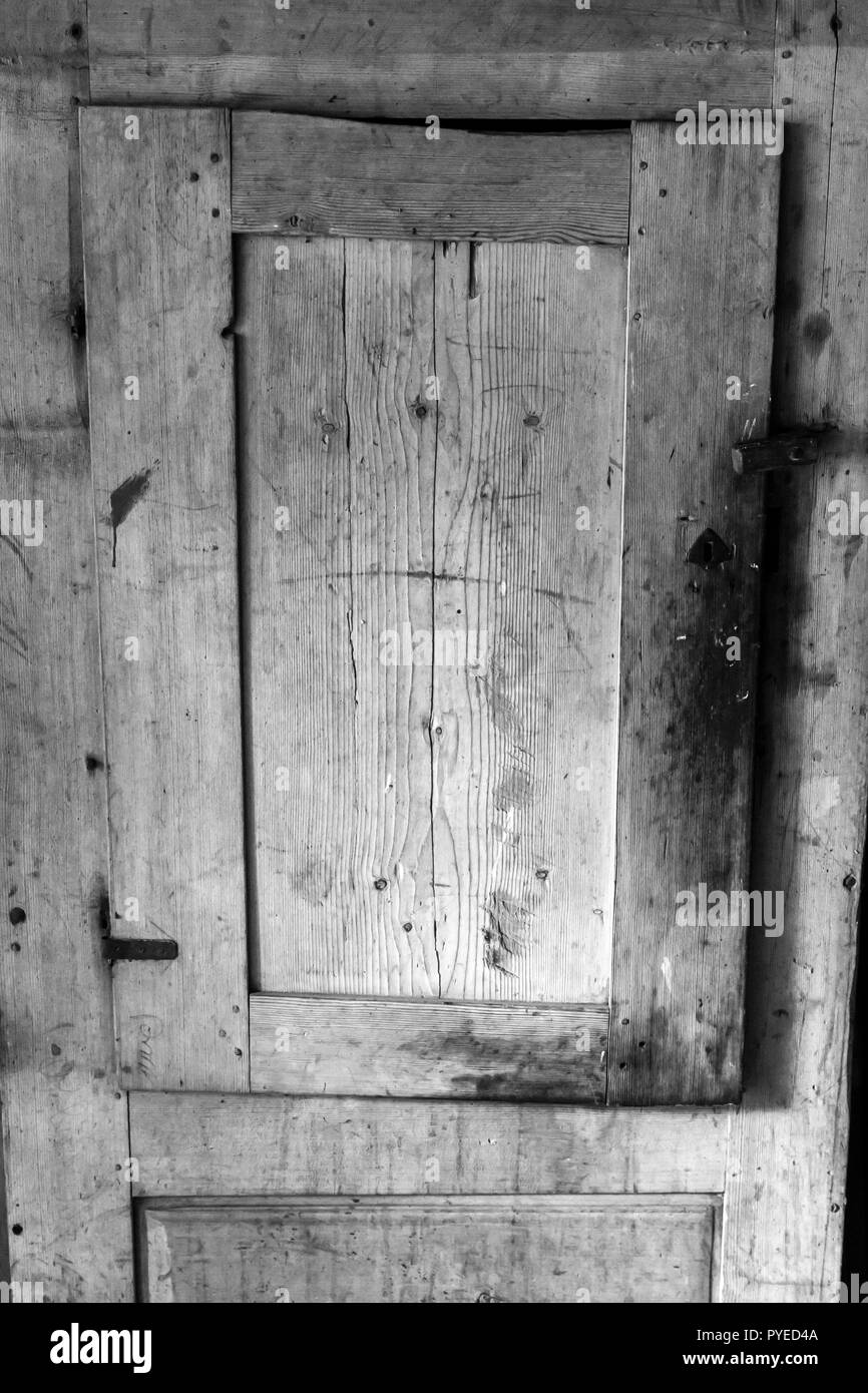 Rustic wooden storage cabinet in an old Swedish farm in northern Sweden - Stock Image