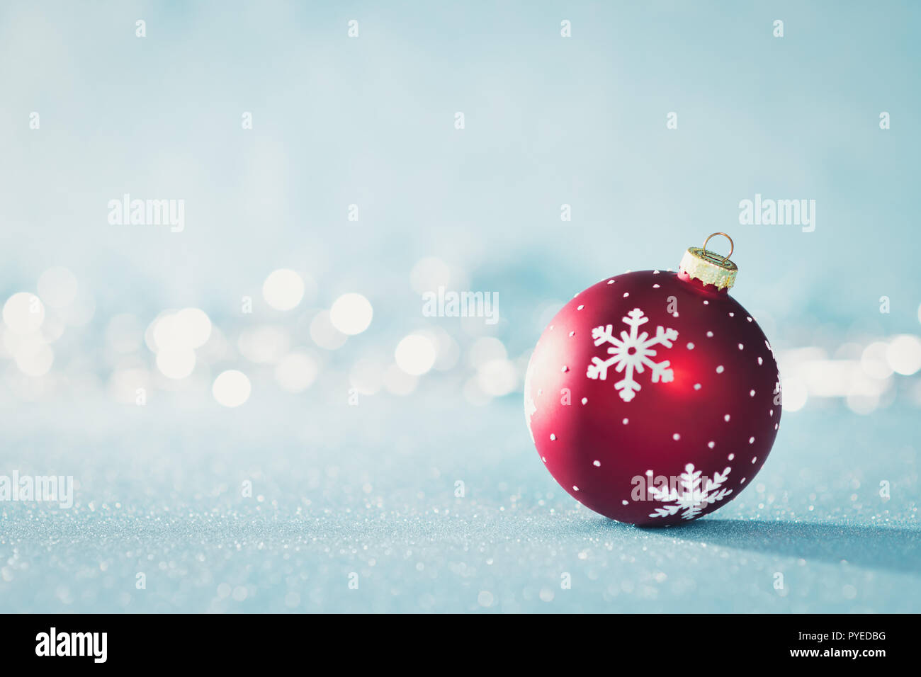 Christmas Background Pic.Bright Red Christmas Bauble In Winter Wonderland Blue