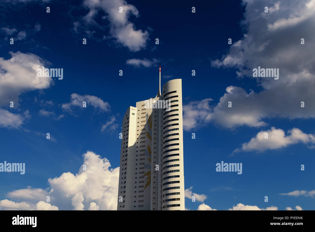 sky scraper with blue sky and clouds in vienna - Stock Image