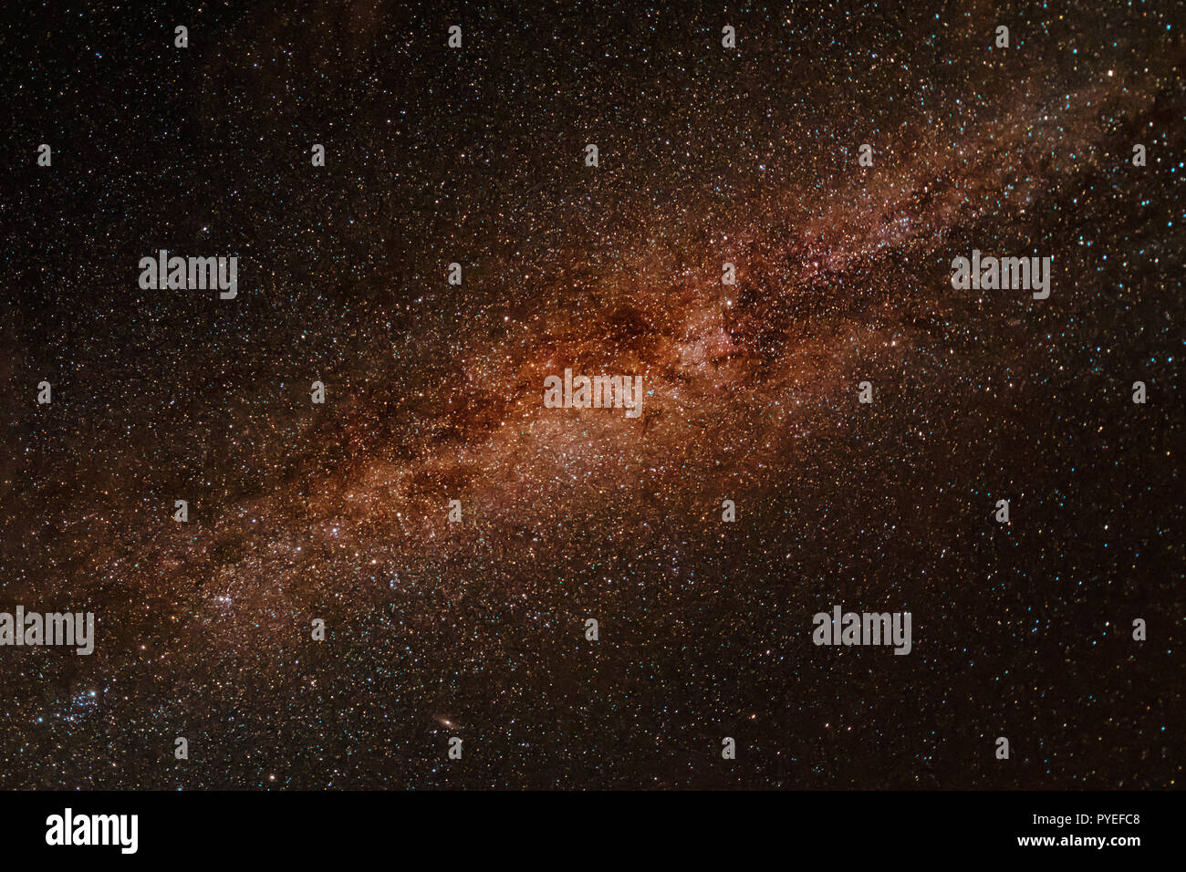 Milky way exposed in great detail and in brown reddish color, looks like space - Stock Image