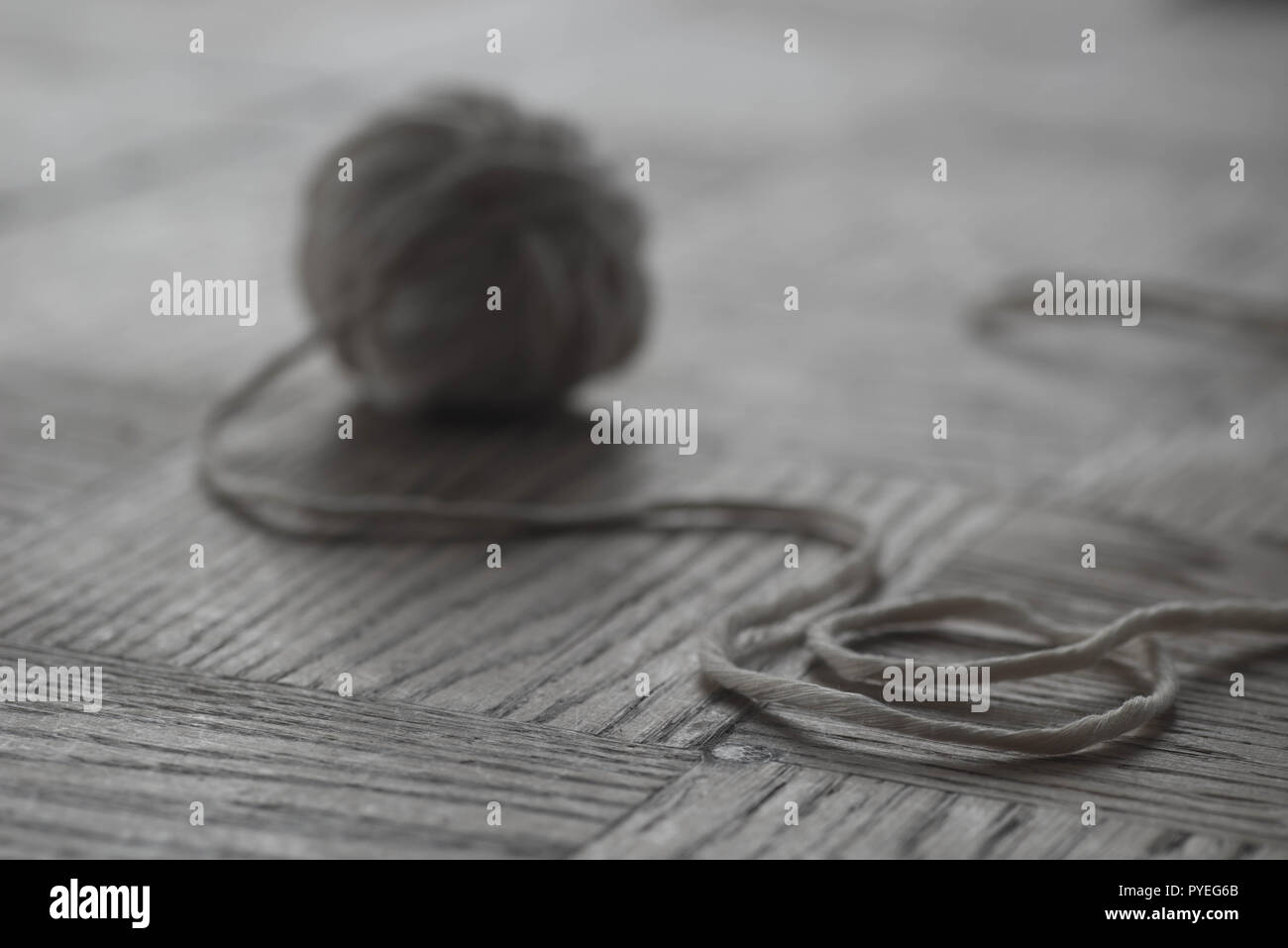 Gray Cotton Ball Of Yarn On Wooden Background Selective Focus Macro Use In Photography For Dummies