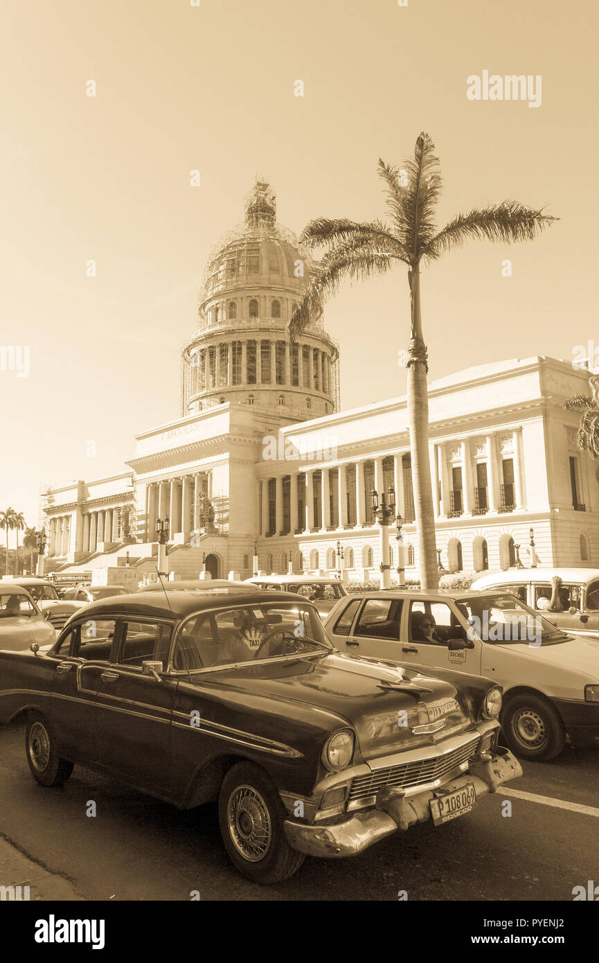 HAVANA, CUBA - JANUARY 16, 2017: A vintage car circulating in front of the Capitol in Havana, Cuba. Cubans, unable to buy newer models, keep thousands - Stock Image
