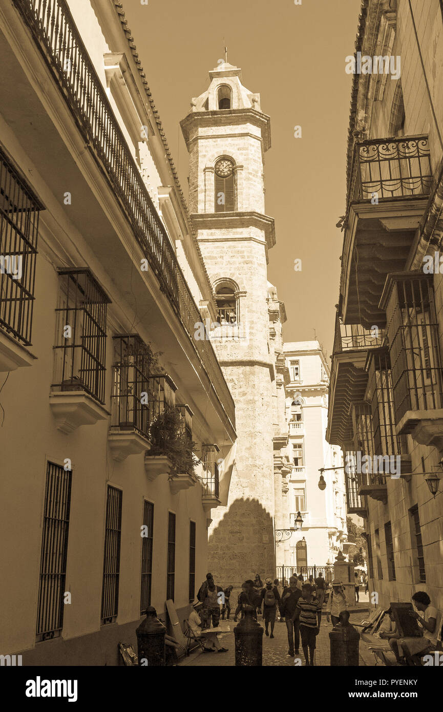 HAVANA, CUBA - JANUARY 16, 2017: Obispo street and Cathedral of Havana. Tourists walking in a daily scene in Old Havana, on a sunny day. Havana, Cuba - Stock Image
