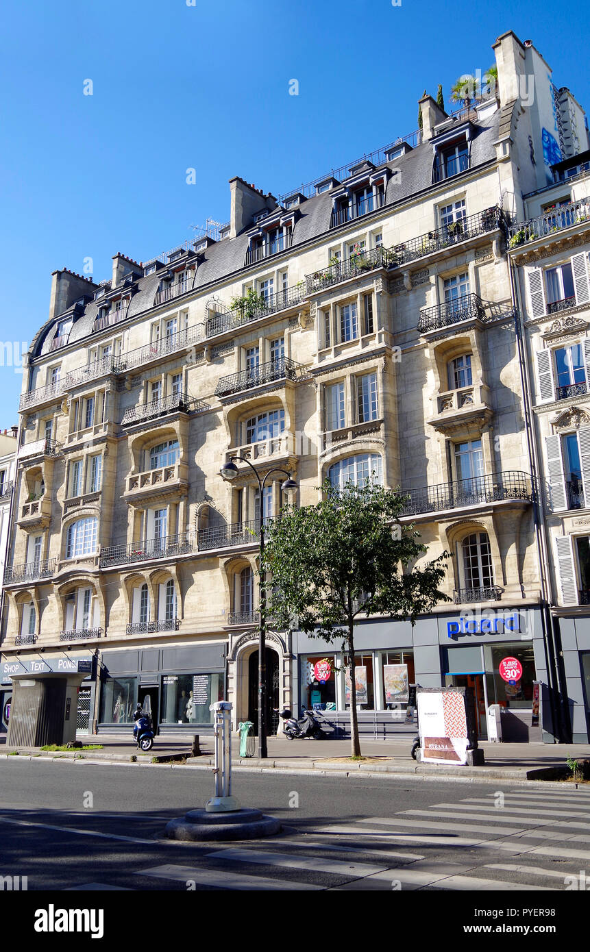 Paris, France, Two residential buildings in a Belle Epoque terrace in Boulevard du Temple, with some influence of Art Nouveau style - Stock Image