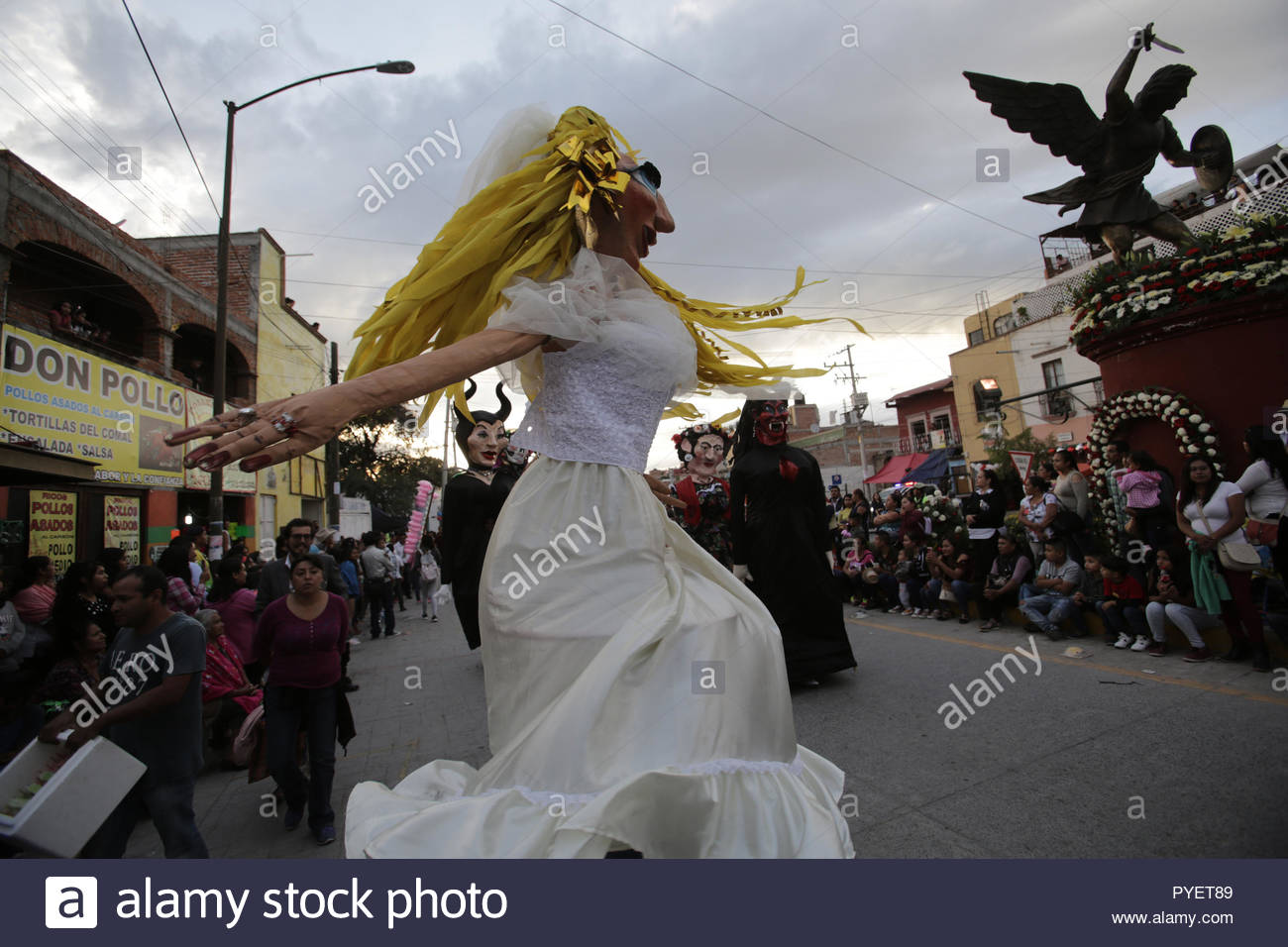 A dancing mojiganga (giant puppet) at an annual festival - Stock Image