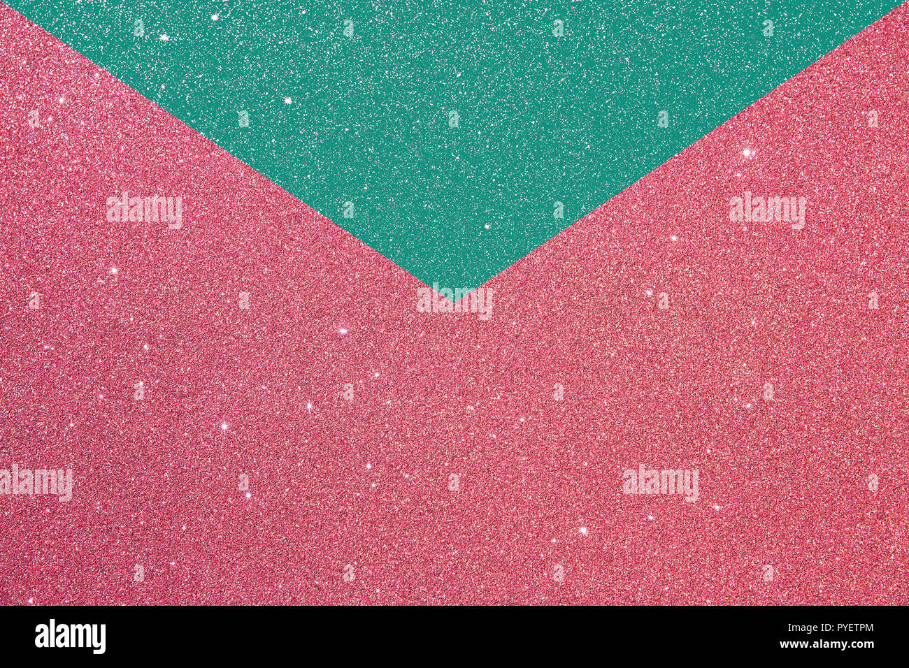 litlle flashes on pink and green  envelope card.background with rough texture - Stock Image