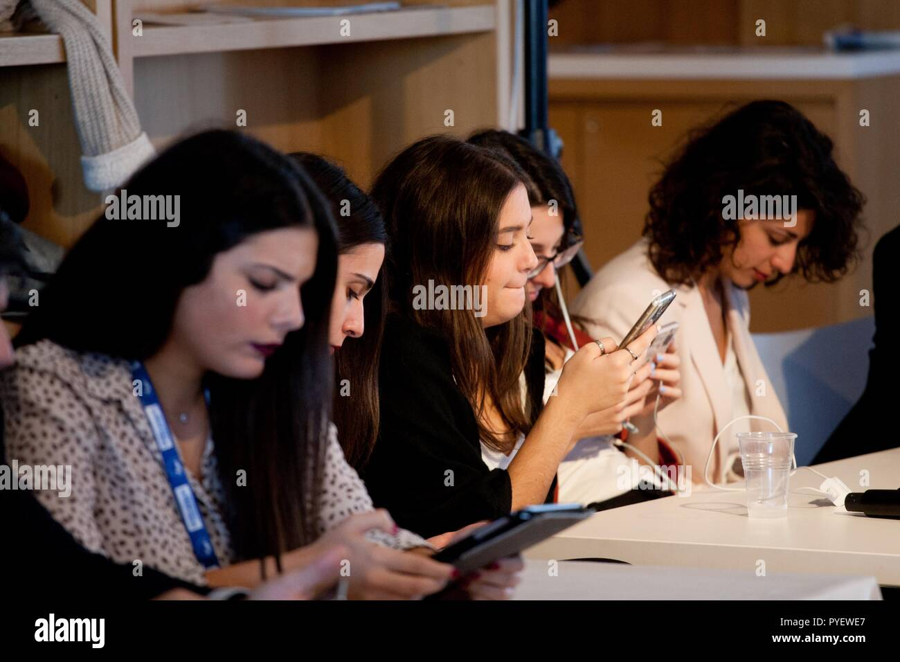 young girls  looking at their cell phones - Stock Image