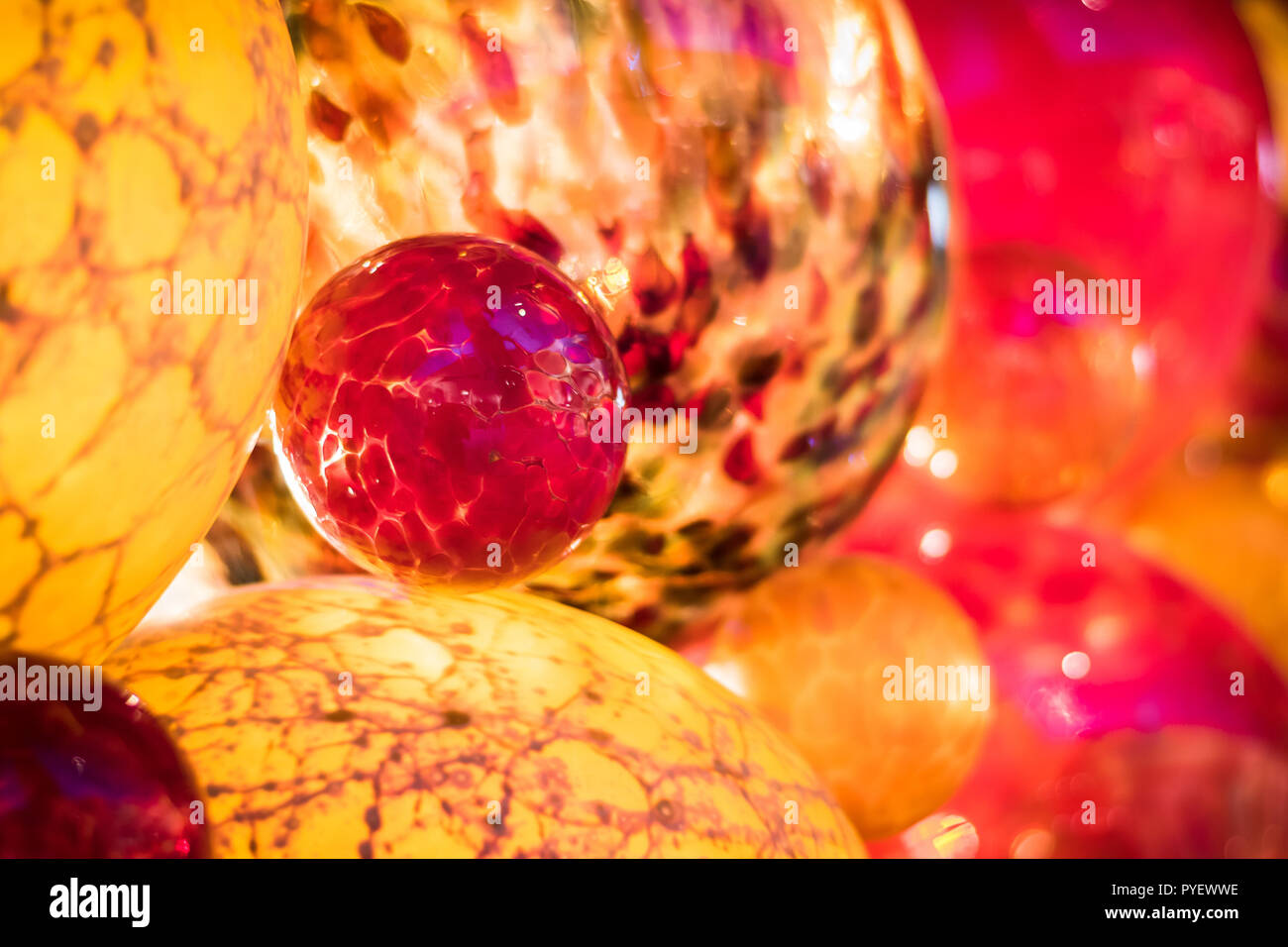 Lovely Christmas greeting card background. Glass hand painted Christmas tree balls that is found in valletta Malta. Bright red and Yellow balls decora - Stock Image