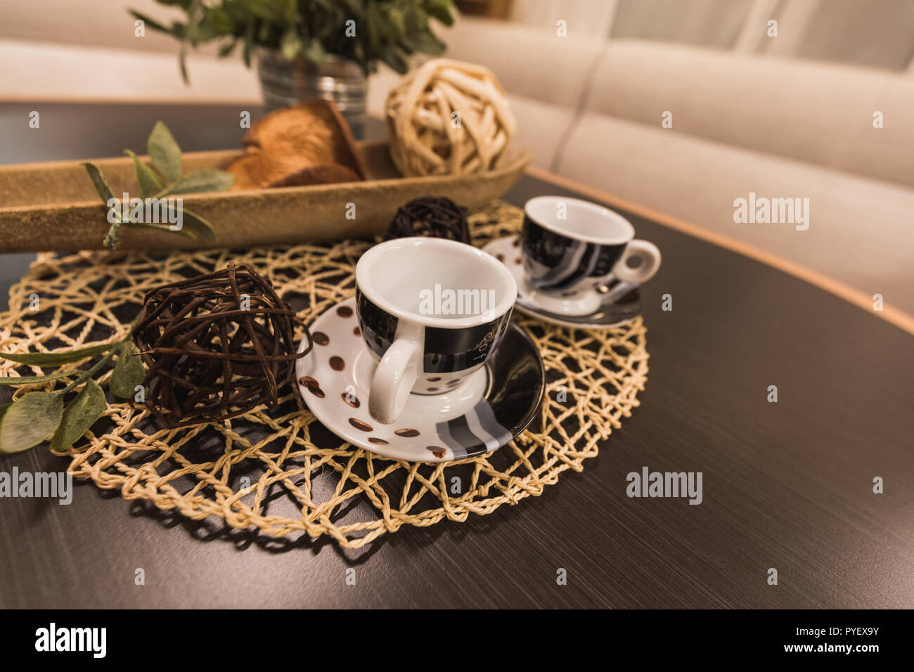 Decorative Straw Balls In Different Colors And Coffee Cups On A Table Inside A Caravan Switzerland Stock Photo Alamy