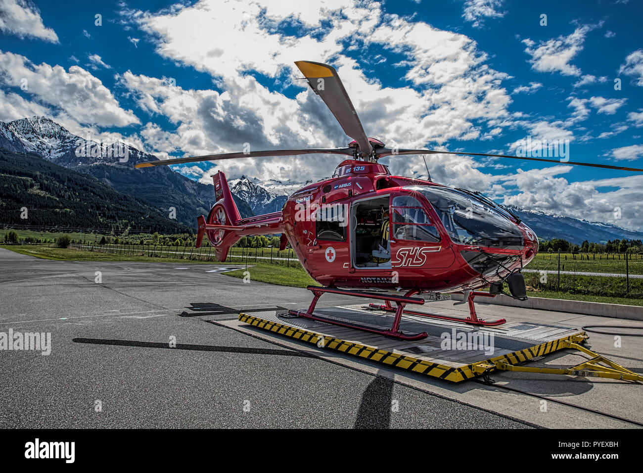 Airbuss EC135 Alpin Heli 6 at the Zell am See Aiirfield - Stock Image