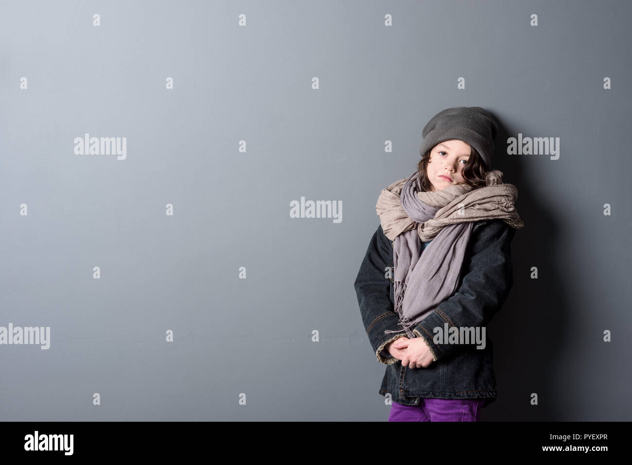 Hopeless girl wearing shabby clothes - Stock Image