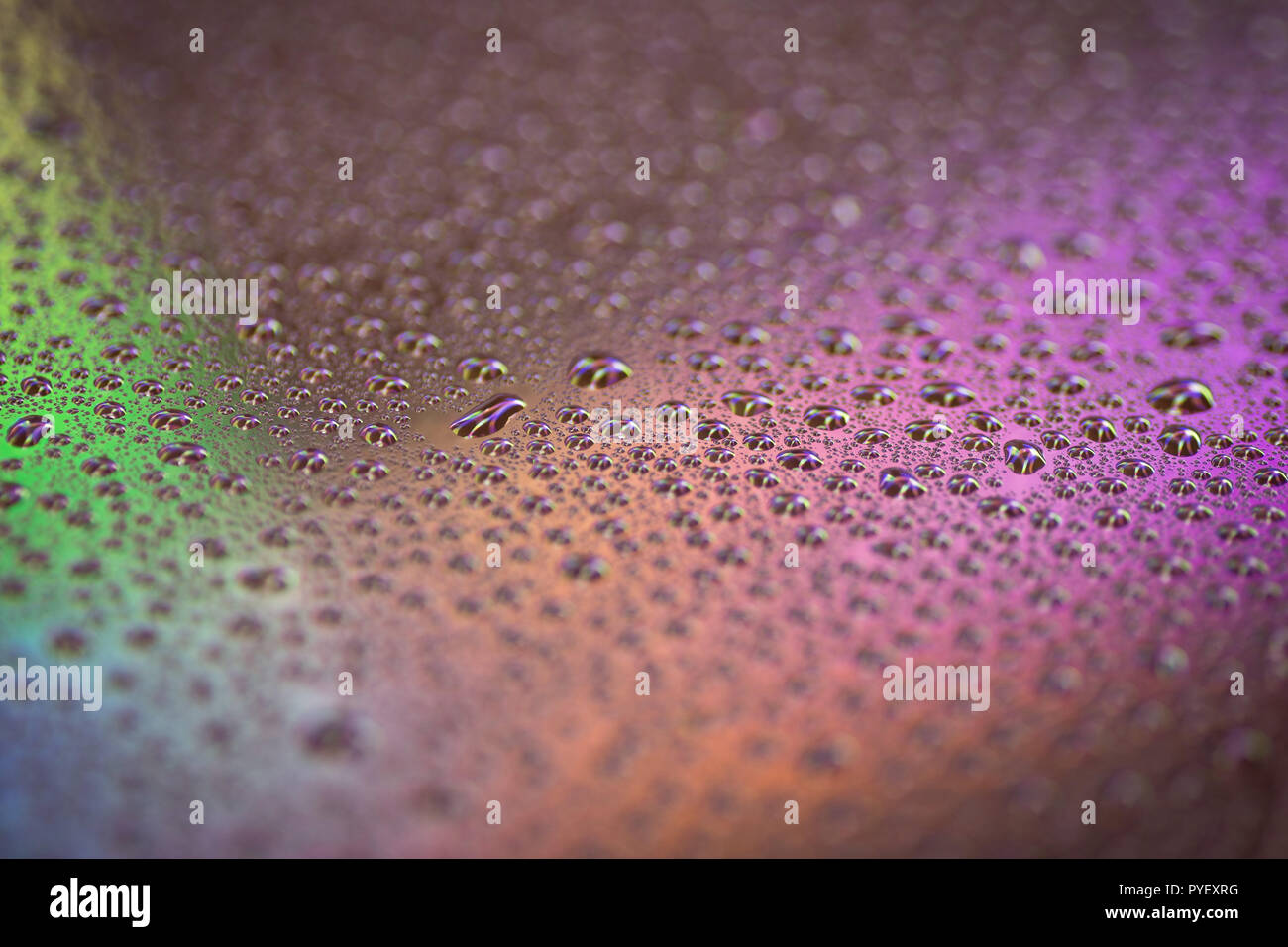Cloys up to water drops on glass background with color light Stock Photo