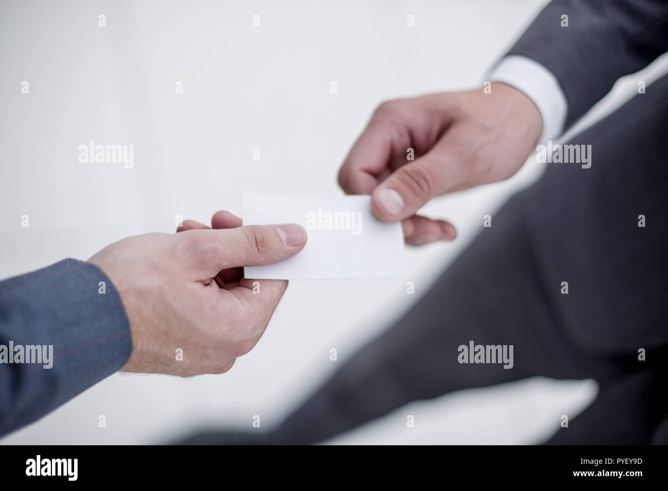 close up.business partners exchanging their business cards - Stock Image