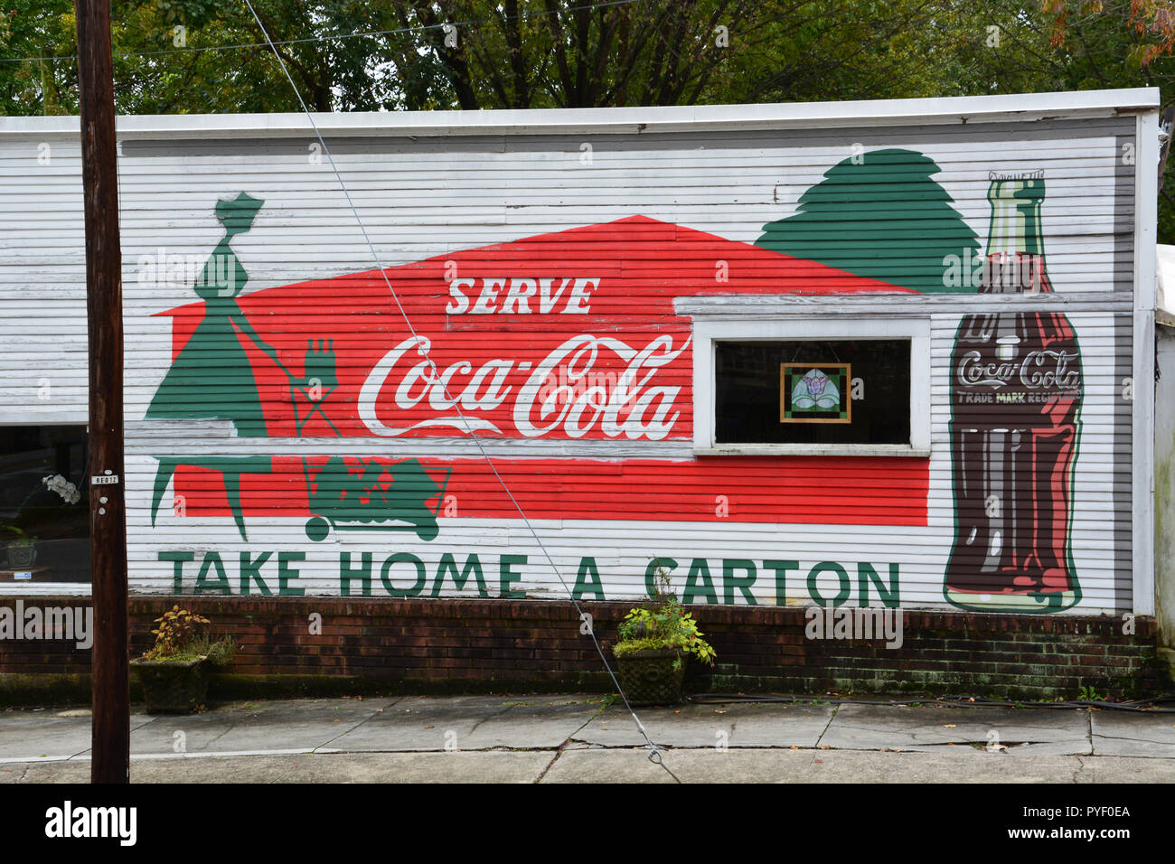 A classic sign for Coca Cola on the side of an old corner store in the historic Oakwood neighborhood of Raleigh North Carolina. Stock Photo