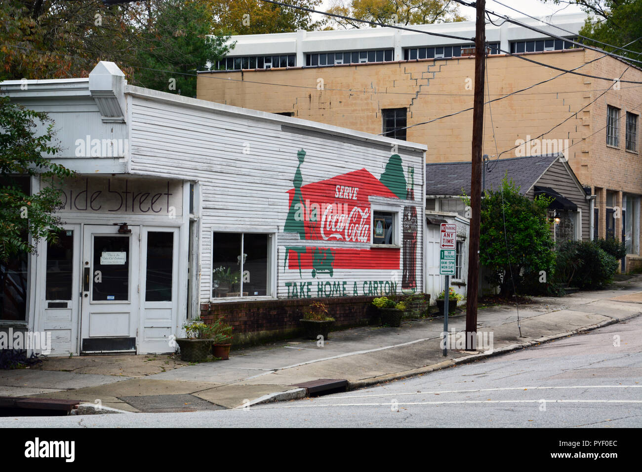 A classic sign for Coca Cola on the side of an old corner store in the historic Oakwood neighborhood of Raleigh North Carolina. - Stock Image