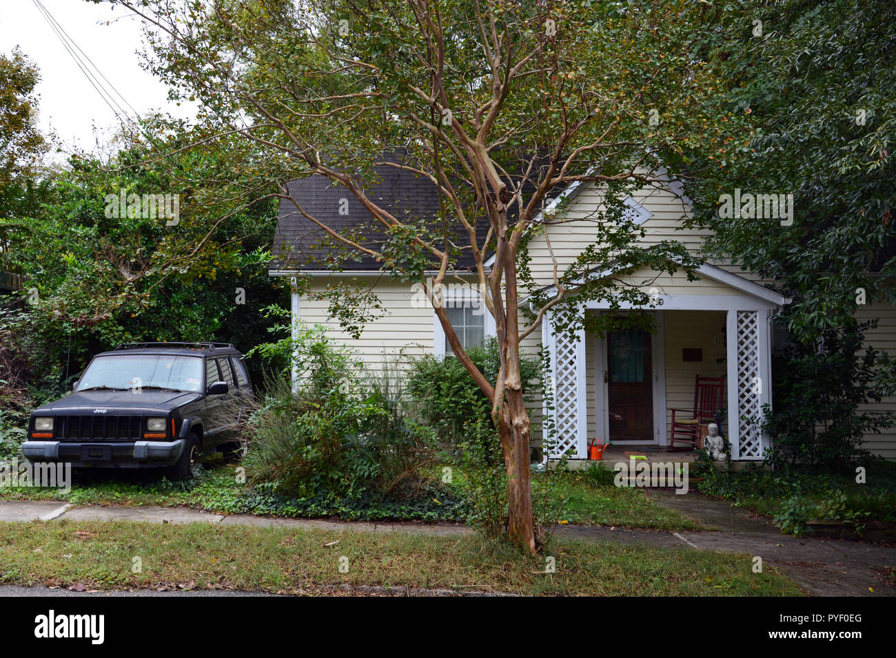 A rundown home with old truck out front in Raleigh North Carolina's historic Oakwood neighborhood. Stock Photo