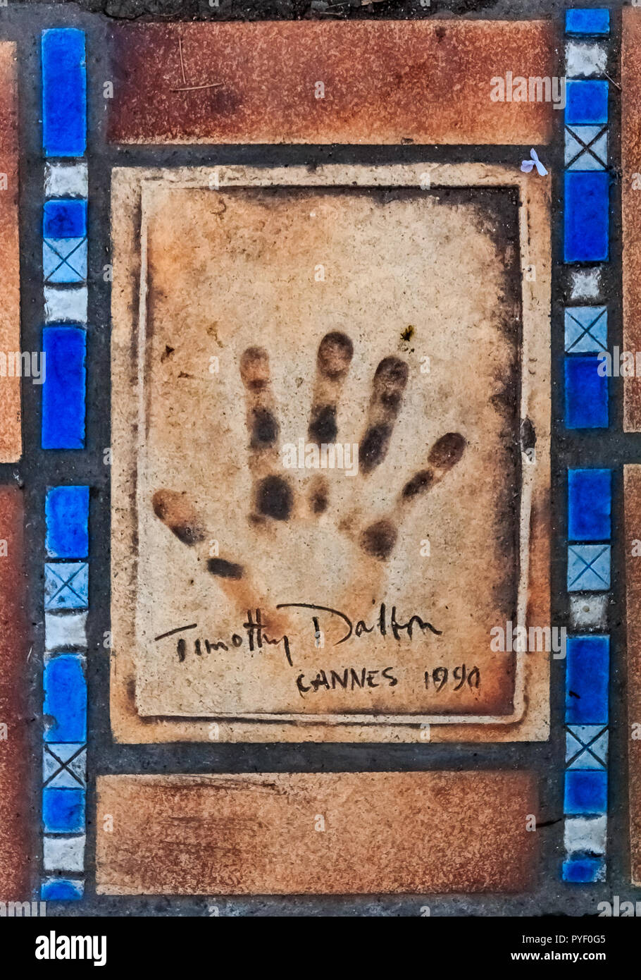 Cannes, France - October 18, 2013: Hand print of Timothy Dalton on the Cannes Walk Of Fame Stock Photo
