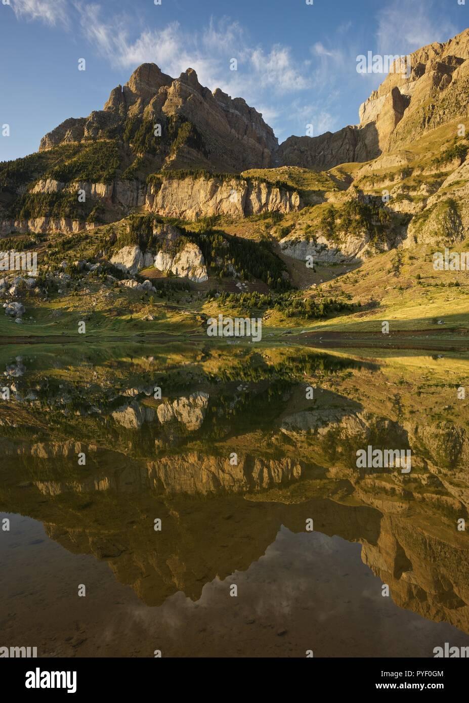 Morning Light and still waters at Ibon de Piedrafita Stock Photo