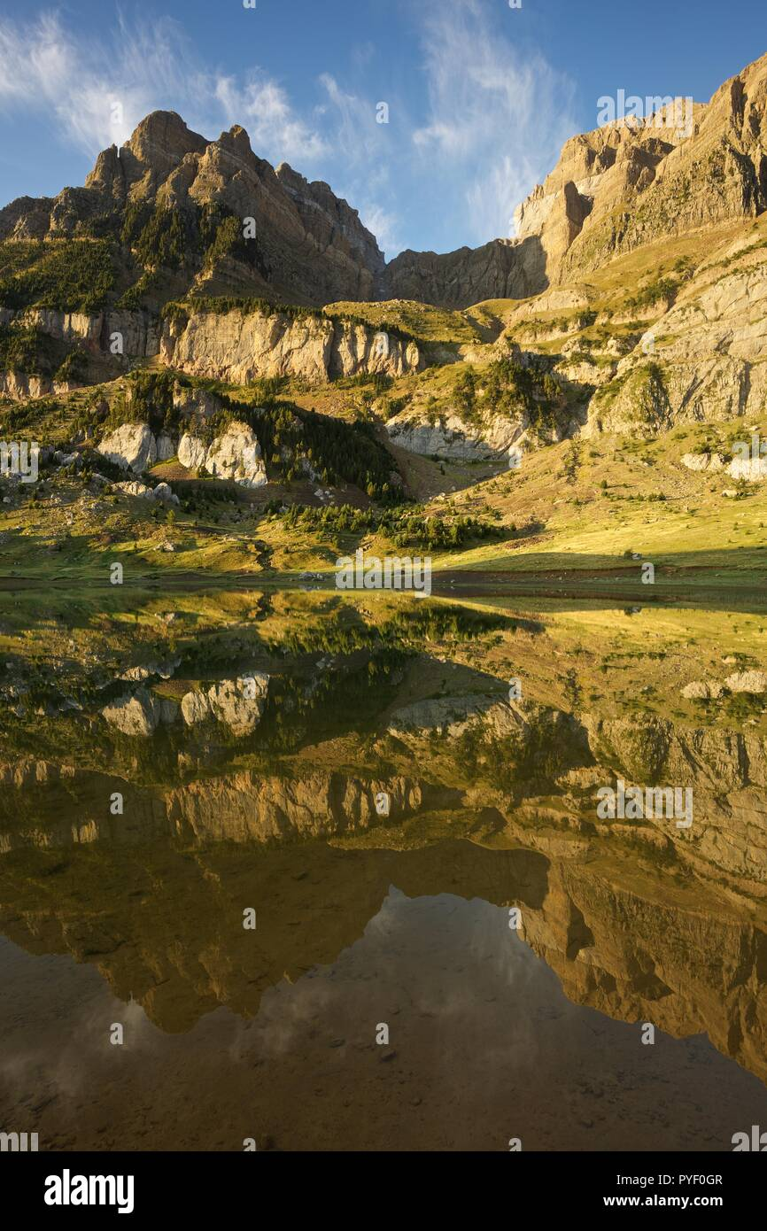 Morning Light and still waters at Ibon de Piedrafita Stock Photo