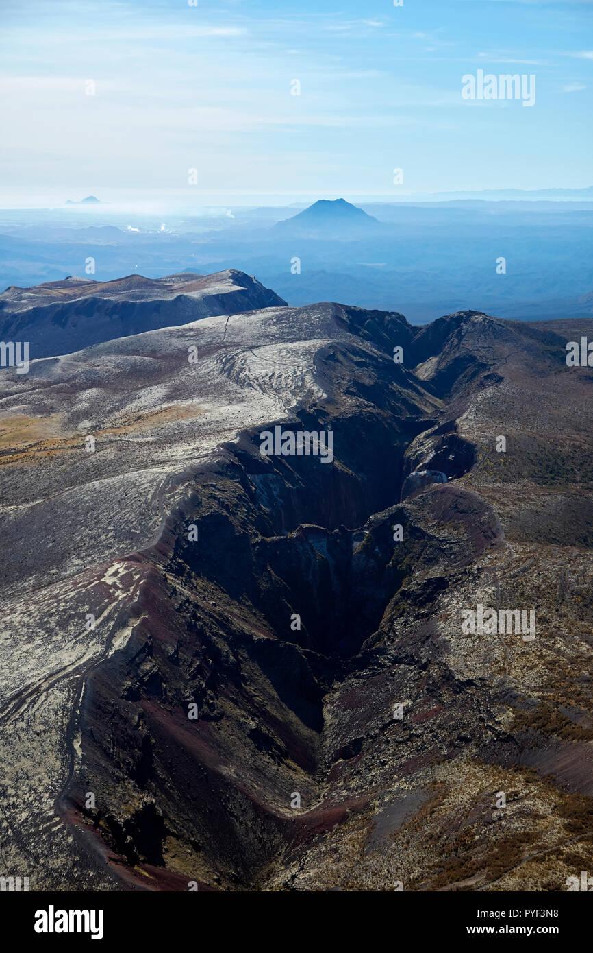 Crater of Mount Tarawera, near Rotorua, and volcanic cone of Putuaki / Mount Edgecumbe in distance, North Island, New Zealand - aerial - Stock Image