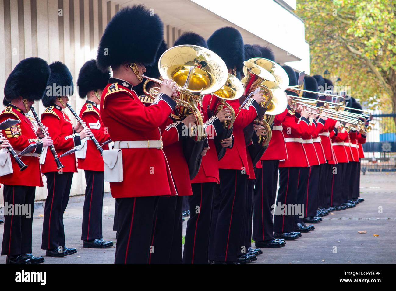 A military band rehearse for the changing of the guard as onlookers watch - Stock Image