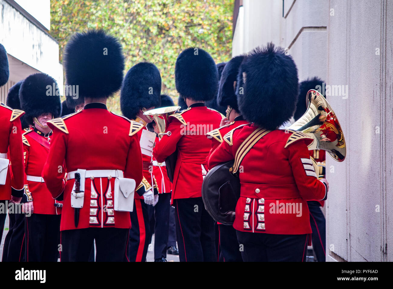 A military band rehearse for the changing of the guard as onlookers watch and take photographs with their smartphones - Stock Image