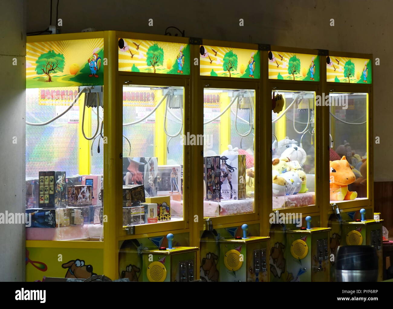 KAOHSIUNG, TAIWAN -- OCTOBER 19, 2018: Claw crane game machines have become the latest fad in Taiwan, occupying many empty store fronts. - Stock Image