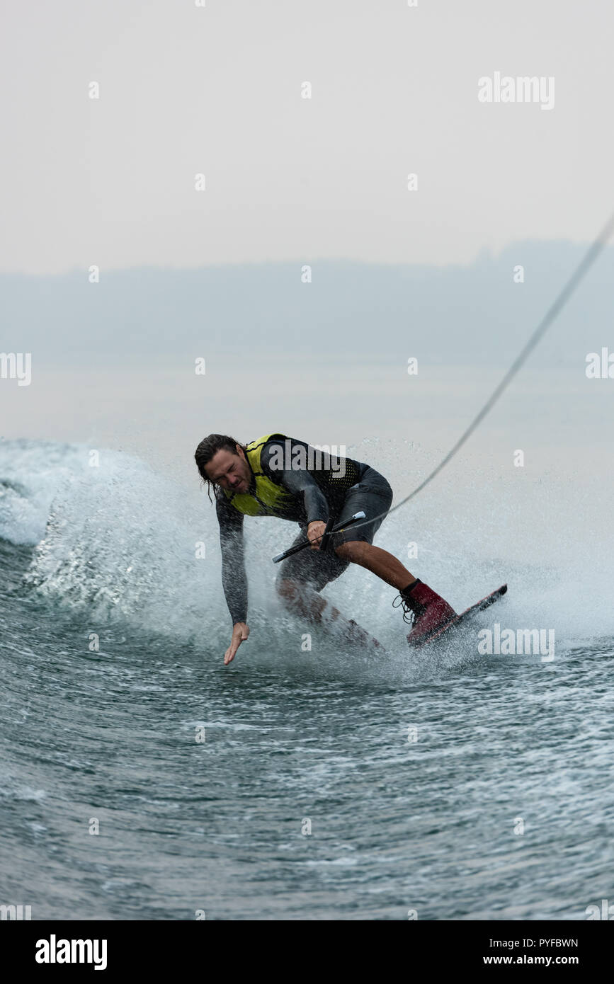 Man wakeboarding in the river - Stock Image