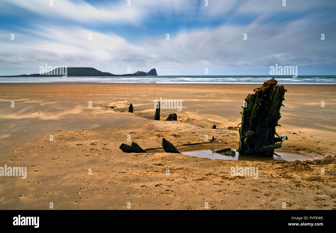 The wreck of the Helvetia and Worm's Head, Rhossili Bay, the Gower Peninsula, South Wales (2) - Stock Image
