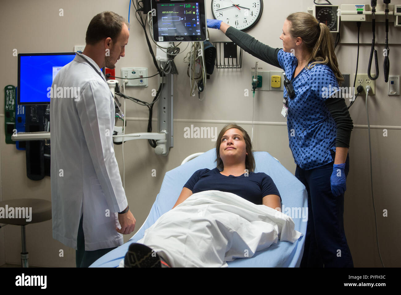 Emergency Room Doctor And Nurse With Patient At Hospital