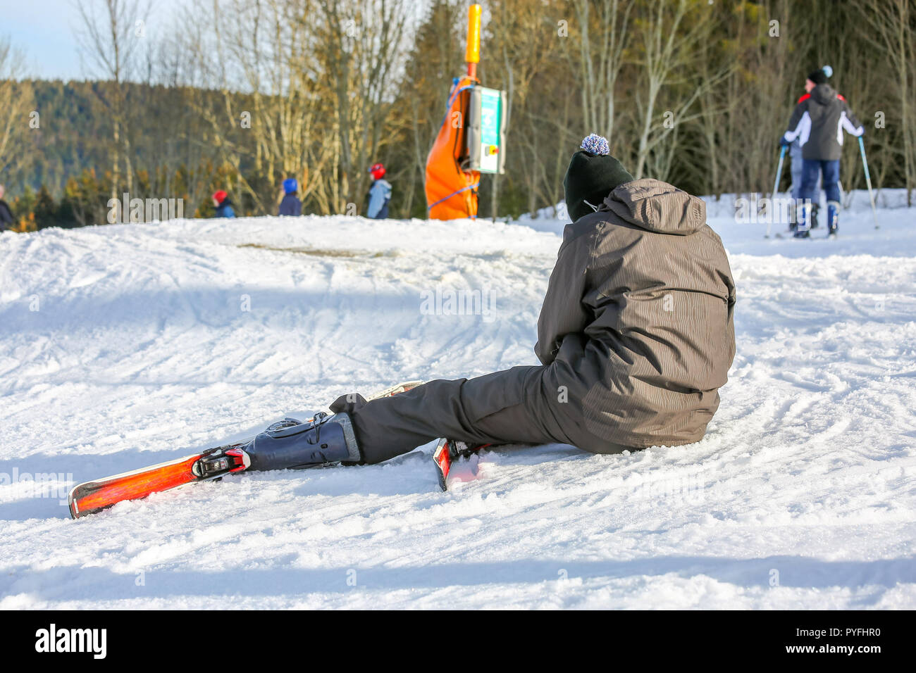 GERARDMER, FRANCE - FEB 16- Beginner skier fell to the ground during the annual winter school holiday on Feb 16, 2015 in Gerardmer, France - Stock Image