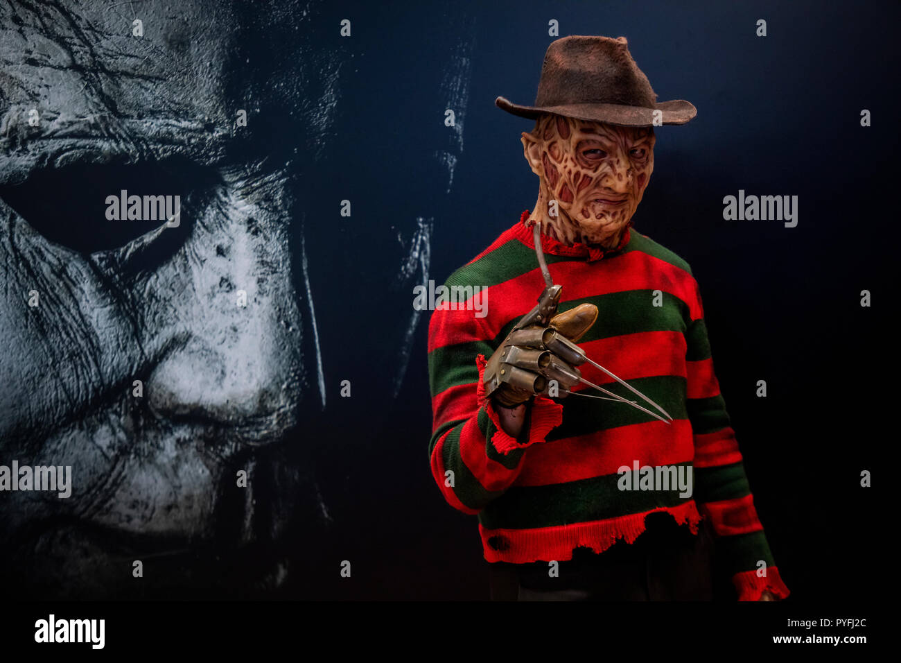 A man in a Freddy Kruger character costume during the Halloween movie presentation at Comic Con Russia exhibition at Crocus Expo in Moscow, Russia - Stock Image
