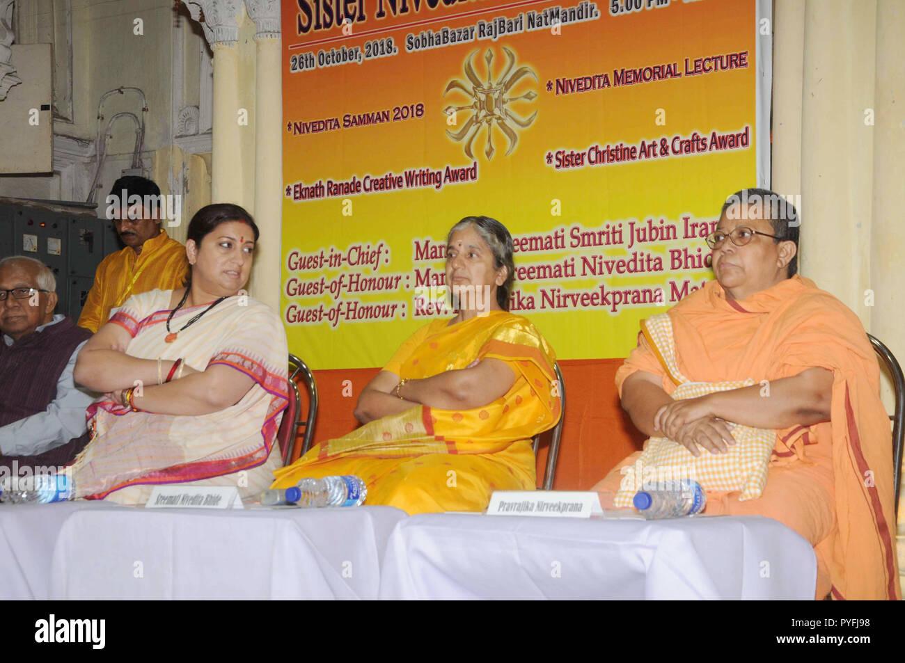Kolkata, India. 26th Oct, 2018. Union Textile Minister Smriti Irani (left) takes part in the inauguration of Sister Nivedita Memorial Lecture at Sovabazaar Rajbari. Credit: Saikat Paul/Pacific Press/Alamy Live News - Stock Image