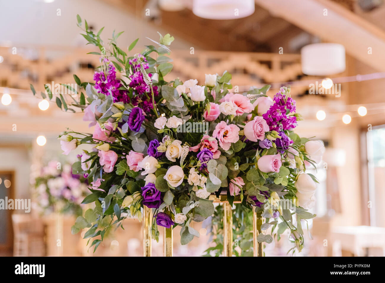 Volume magnificent composition from flowers at a wedding. - Stock Image