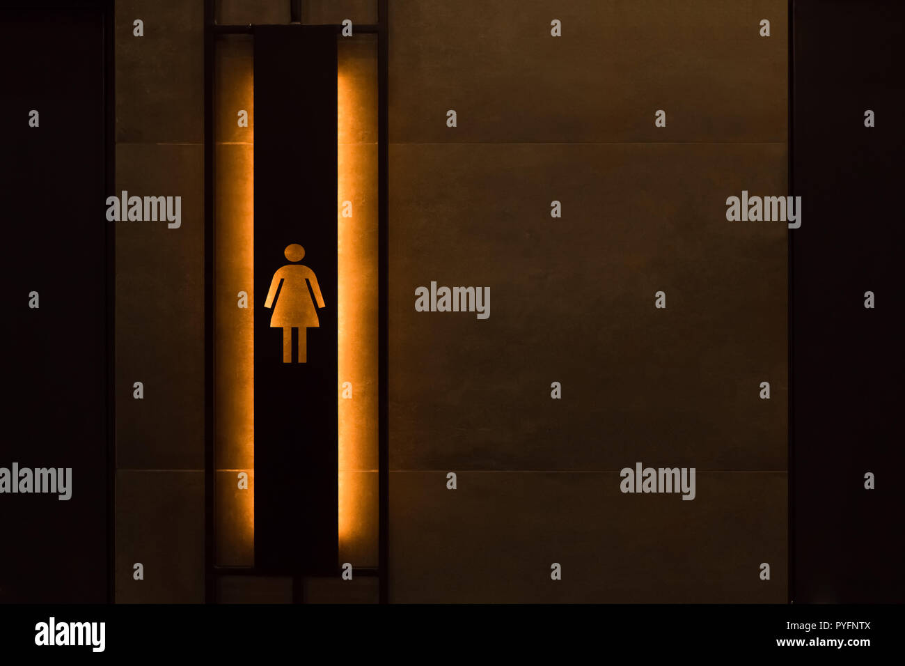 Female restroom sign. Restroom signs in public place. Important signs and symbols concept. Simple sign of WC. Restroom concept. Restroom sign on a toilet door. - Stock Image