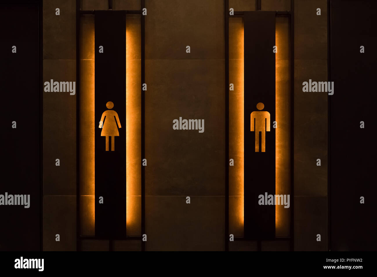 Restroom concept. Restroom sign on a toilet door. Female and male restroom sign. Restroom signs in public place. Important signs and symbols concept. Simple sign of WC. - Stock Image