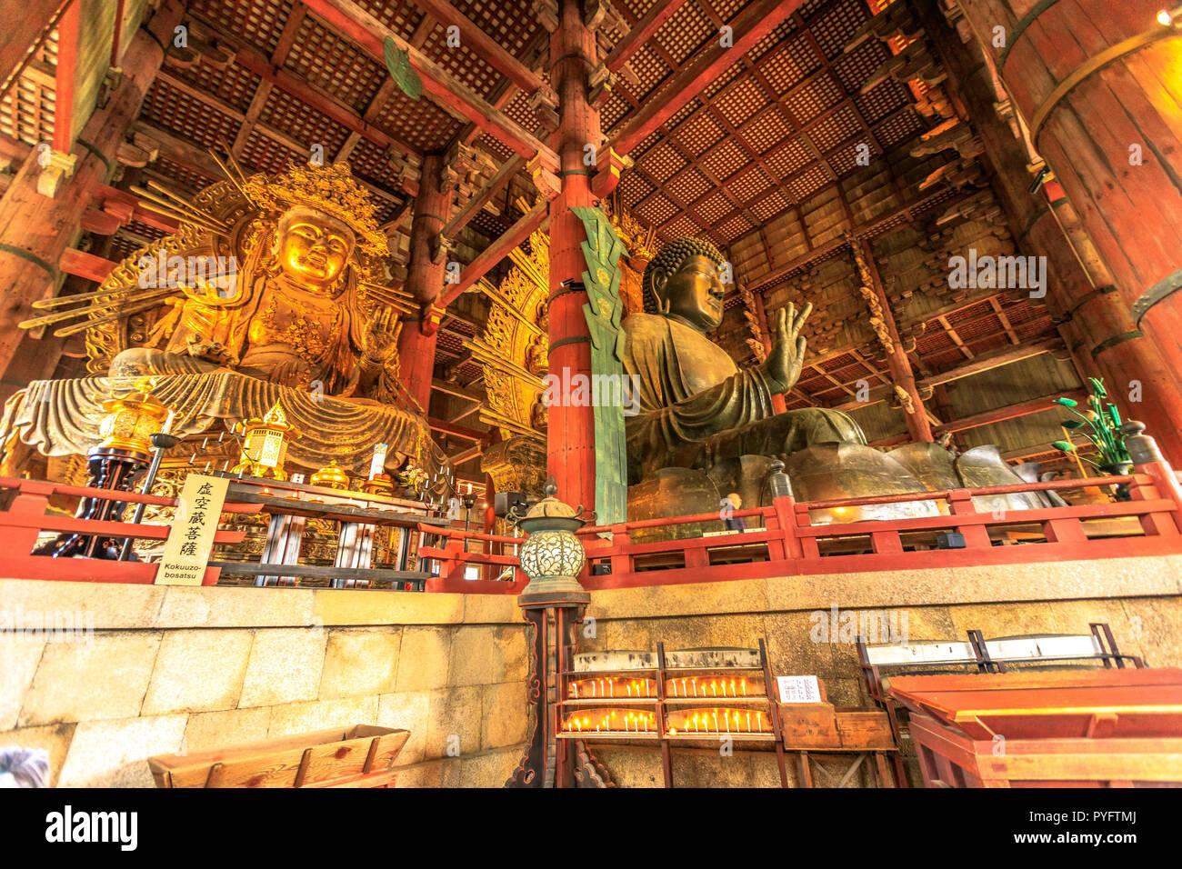 Nara, Japan - April 26, 2017: the Great Buddha or Daibutsu, the world's largest bronze statue of Buddha Vairocana, in the Great Buddha Hall of Todai-ji a Buddhist temple in Nara. UNESCO Heritage Site. - Stock Image