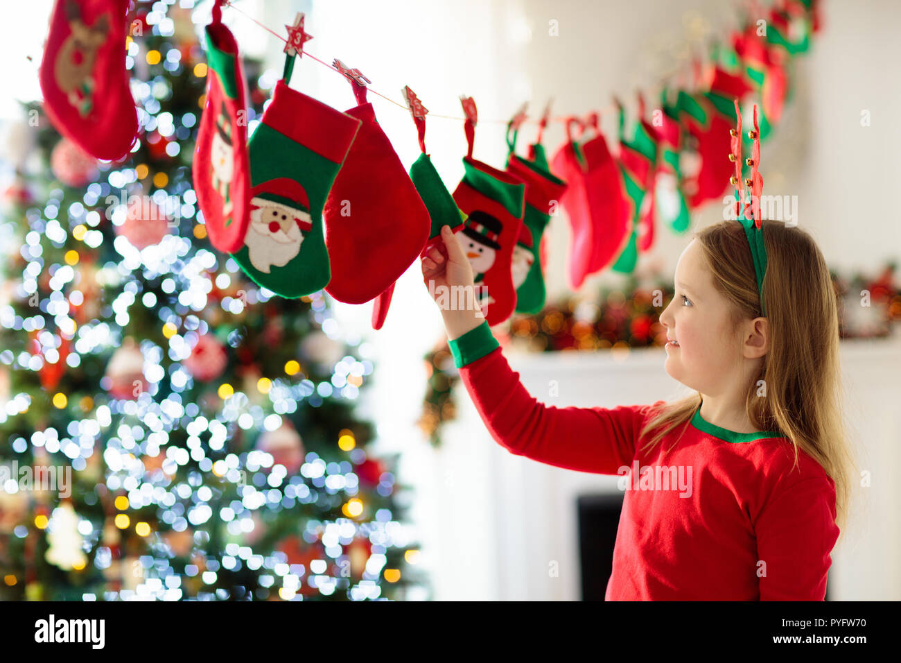 Kids opening Christmas presents. Child searching for candy and gifts ...