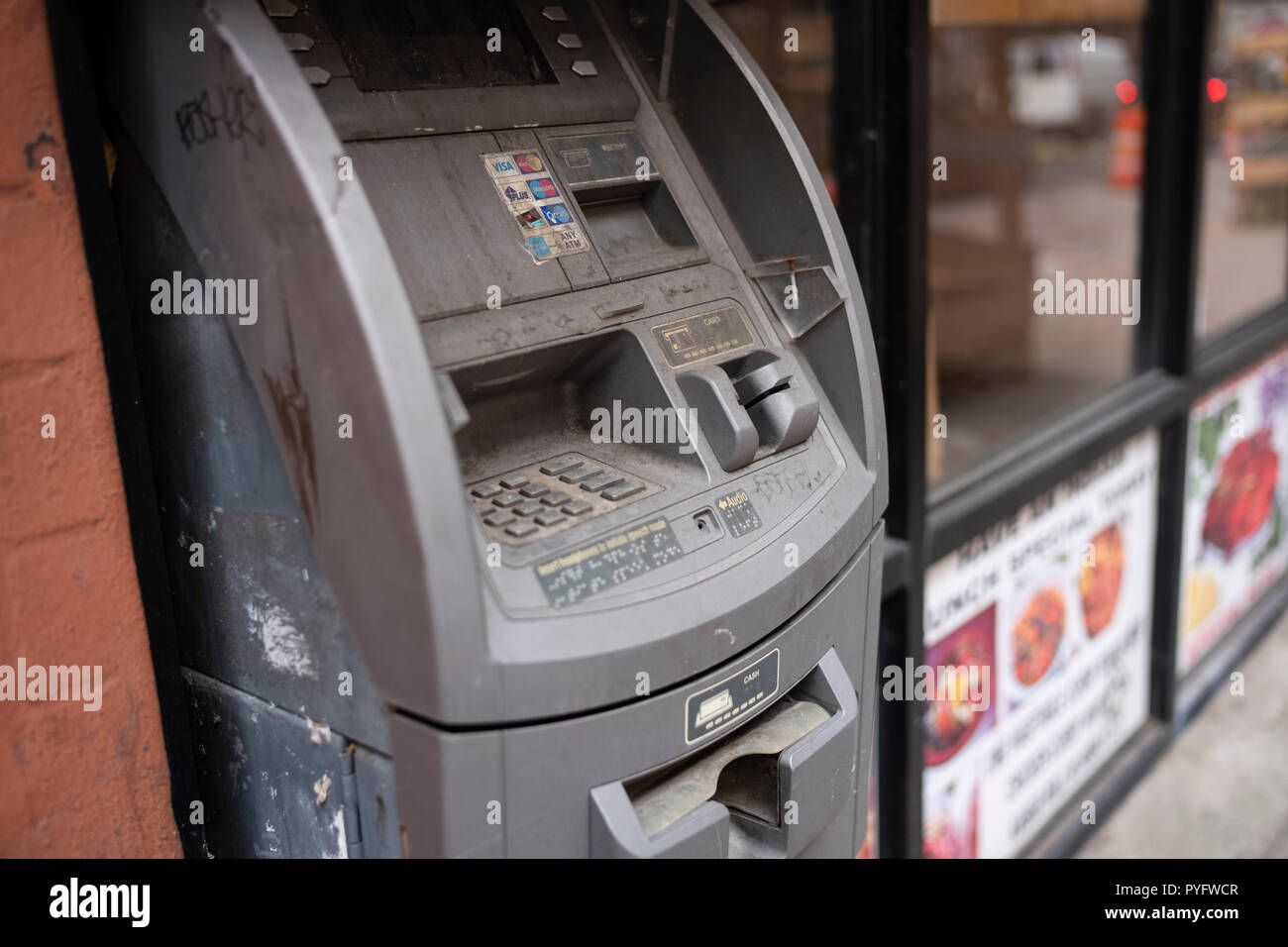 Is cash dead? An outdated ATM machine, Hell's Kitchen, New York City, NY. - Stock Image