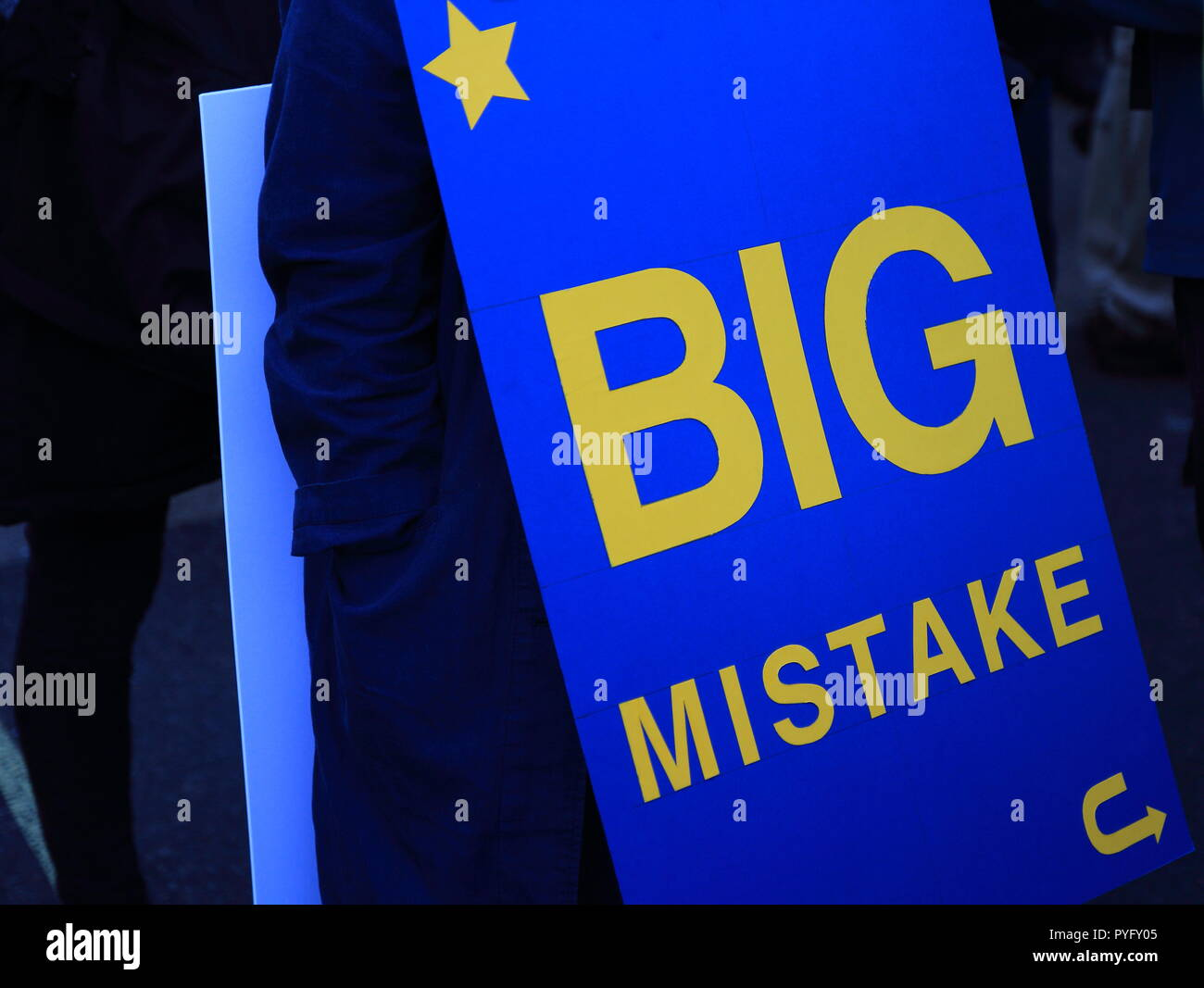 Man holds the blue banner Big mistake - Stock Image