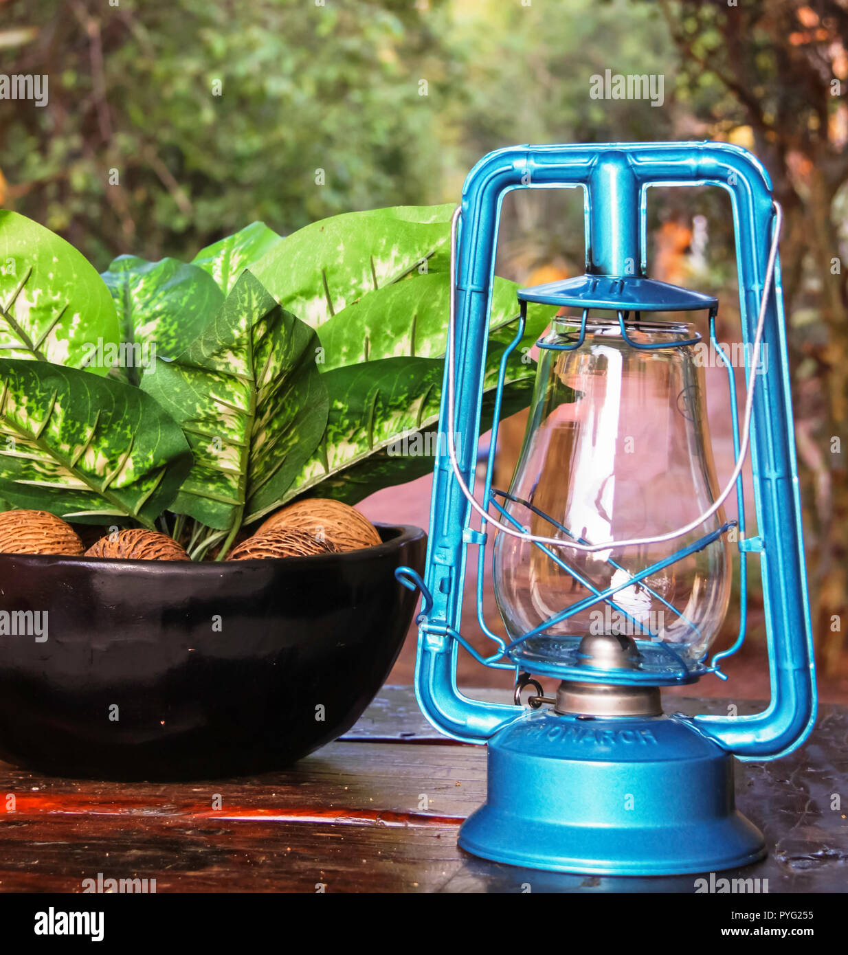 Kruger National Park, South Africa - 2011: Blue kerosene lamp on a table at a game lodge in Kruger National Park - Stock Image