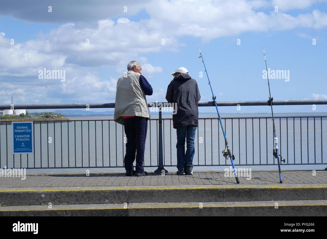 Two fishermen, Cardiff Bay Barrage, Cardiff, South Wales, United Kingdom - Stock Image