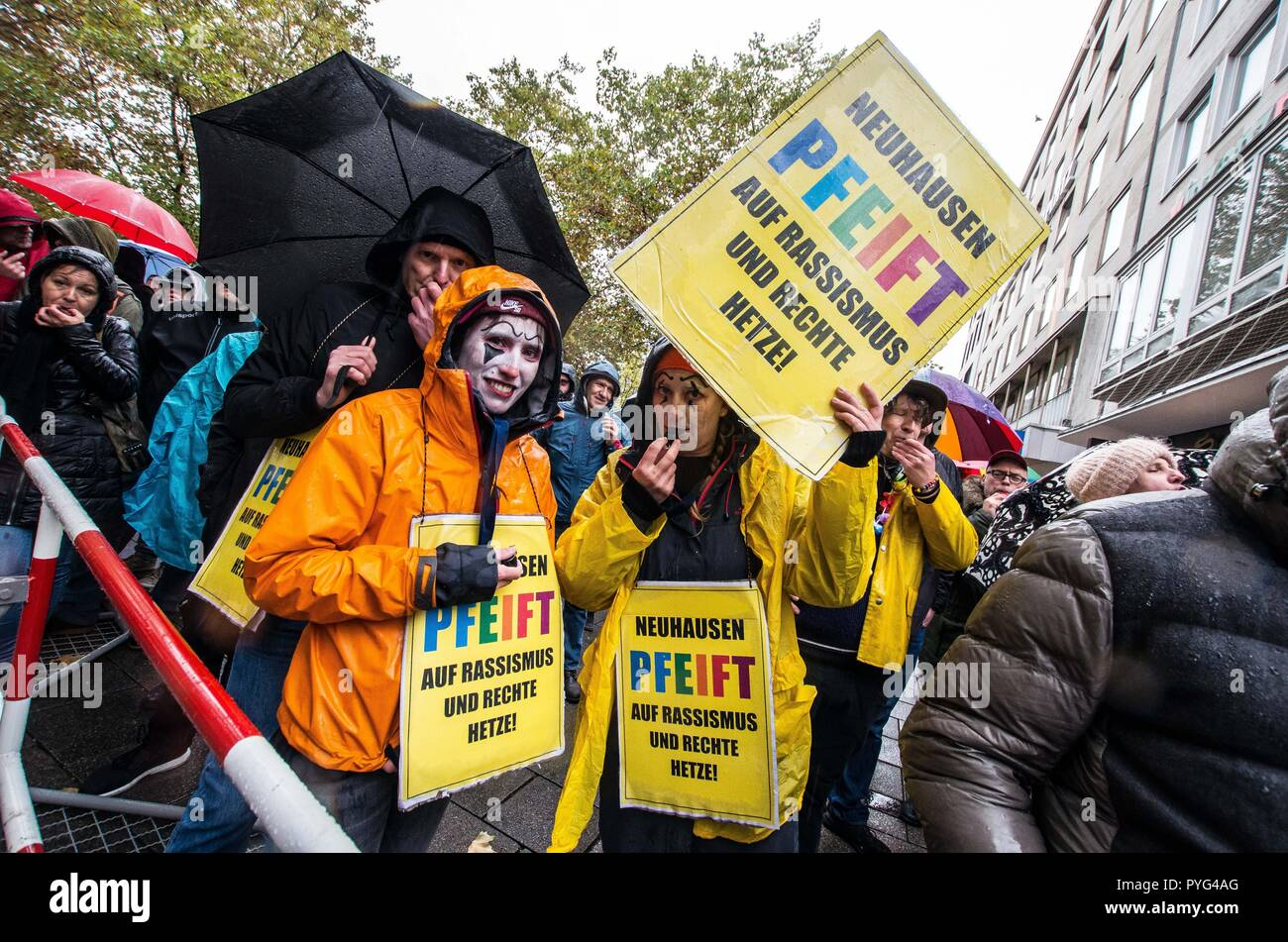 """Munich, Bavaria, Germany. 27th Oct, 2018. Counter-demonstrators against Pegida using the ''Neuhausen Pfeift'' action signs. Attempting to draw more followers and expand PEGIDA into Bavaria, """"Pegida Dresden"""""""" announced an appearance by founders LUTZ BACHMANN and SIEGFRIED DAEBRITZ in Munich's Neuhausen district. Ultimately, the two did not arrive, leaving approximately 40 Pegida followers to march against over 450 counter-demonstrators. Pegida Dresden in Munich is actually Pegida Nuremburg who is attempting to expand south to Munich where the rival Pegida Muenchen is already active. Stock Photo"""