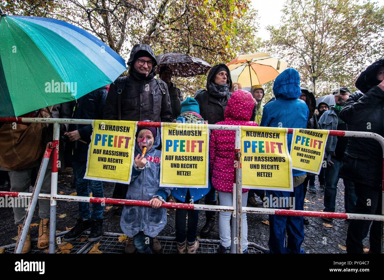 """Munich, Bavaria, Germany. 27th Oct, 2018. Counter-demonstrators against Pegida. Attempting to draw more followers and expand PEGIDA into Bavaria, """"Pegida Dresden"""""""" announced an appearance by founders LUTZ BACHMANN and SIEGFRIED DAEBRITZ in Munich's Neuhausen district. Ultimately, the two did not arrive, leaving approximately 40 Pegida followers to march against over 450 counter-demonstrators. Pegida Dresden in Munich is actually Pegida Nuremburg who is attempting to expand south to Munich where the rival Pegida Muenchen is already active. The latter group is more closely associated Stock Photo"""
