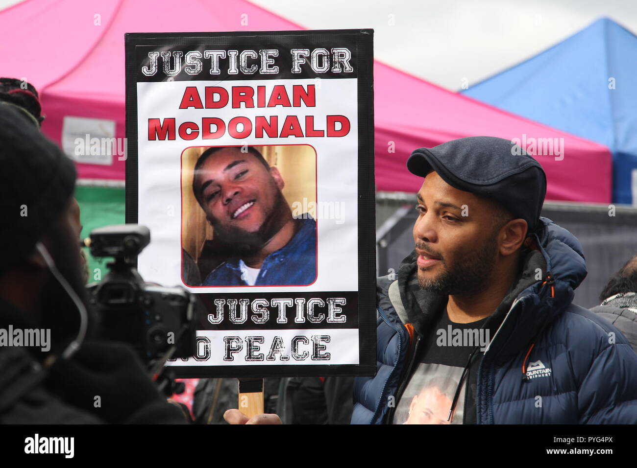 London, UK, 27th October, 2018. Friends, family and supporters campaigning for justice for people who died in custody, or while being arrested  take part In the 20th annual march organised by the United Families and Friends Campaign. Officers were found guilty of misconduct following the death of Adrian McDonald in 2014. The march  goes from Trafalger Square to Downing Street, where a petition is handed in. Roland Ravenhill/Alamy Live News. - Stock Image